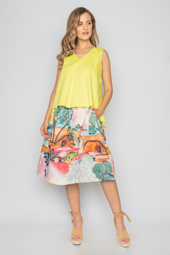 Sleeveless yellow top with decorative bow on the back