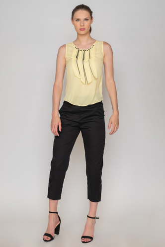 Yellow sleeveless blouse with black pearls