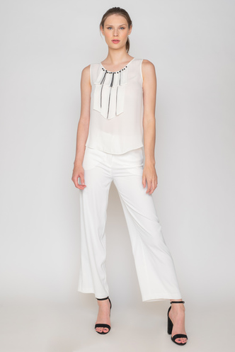 White sleeveless blouse with black pearls