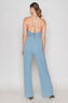 Light blue jumpsuit with glitter and silver belt
