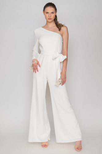 White jumpsuit with one shoulder and fringes on the sleeve