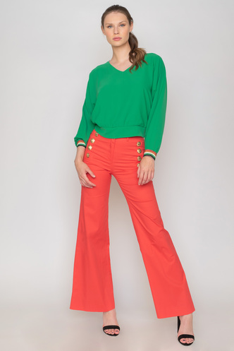 Green crop top with long sleeves and rally