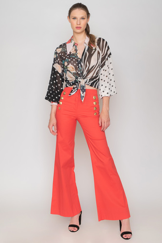High-waisted red pants with gold buttons and pockets