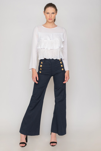 High-waisted blue pants with gold buttons and pockets