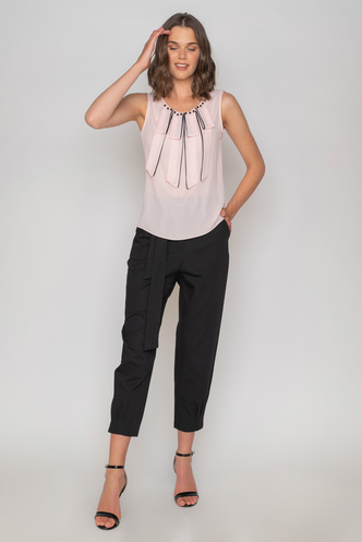 Pink sleeveless blouse with black pearls