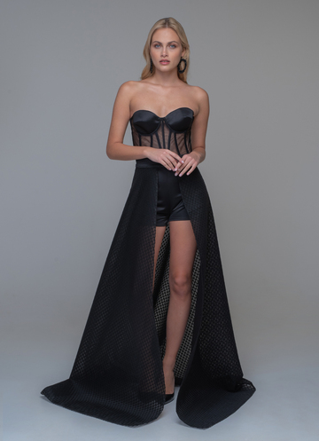 Strapless black evening dress from body and extra skirt